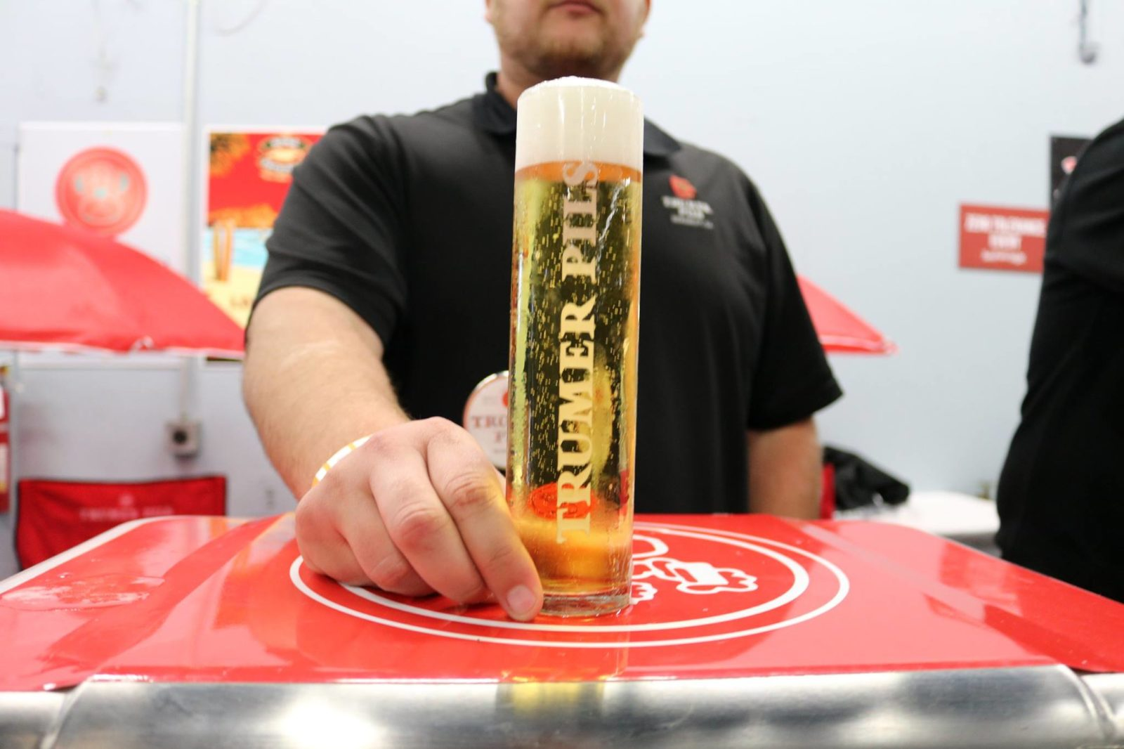 Man holding Trumer Pils glass